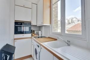 15942-location-meublee-en-courte-duree-dun-appartement-f3-avec-2-chambres-a-jules-joffrin-montmartre-paris-18eme-arrondissement