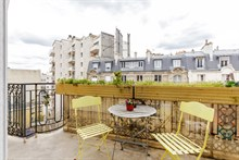 Business stays in short term apartment rental w balcony near metro Charles Michel in Paris 15th