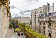 Business stays in short term flat rental w balcony near metro Charles Michel in Paris 15th