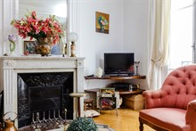 Luxury monthly apartment rental w decorative fireplace for 6 near Moulin Rouge apartment on rue Marcadet, Paris 18th