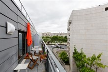 modern studio apartment with terrace furnished for 4 guests 377 sq ft Bir Hakeim Paris XV