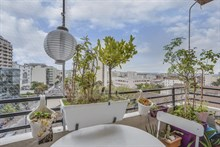 Seasonal furnished rental large studio alcove for two with balcony + view around corner from metro in Vanves