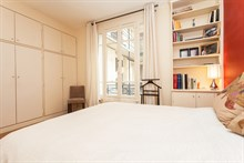Enjoy a short-term apartment stay for 4 with 2 fully furnished rooms and a mini-library in the Swiss Village, Paris 15th