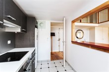 Family friendly apartment duplex with hardwood floors and bright colors for short term vacation rental in Paris 17th with access to metro station Perrier
