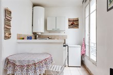 2-person 2-room apartment for monthly rent, furnished with bed and fold-out couch on rue du Faubourg Saint Denis Paris 10th